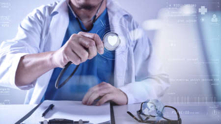 Medical techonlogy concept,smart doctor hand working with modern computer in hospital office with virtual icon diagram