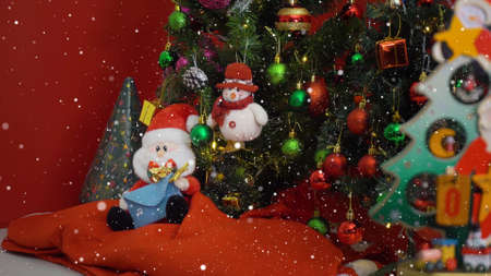 Greeting Season concept. Santa Claus and Snow man with ornaments on a Christmas tree with decorative light
