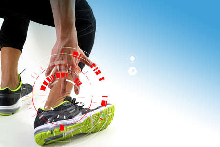 Runner sportsman holding ankle in pain with Broken twisted joint running sport injury and Athletic man touching foot due to sprain with VR medical scanning