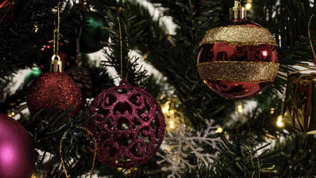 Greeting Season concept.close up of ornaments on a Christmas tree with decorative light