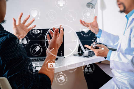 Medical doctor in white uniform gown coat consulting businessman patient having exam as Hospital professionalism concept with VR icon diagram Standard-Bild