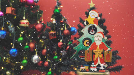 Greeting Season concept.Santa Claus show 50 days till Xmas with ornaments on a Christmas tree with decorative light Standard-Bild