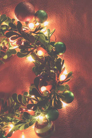 Greeting Season concept.Christmas wreath with decorative light on red background Standard-Bild