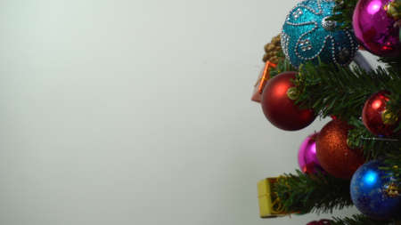 Greeting Season concept.hand setting of ornaments on a Christmas tree with decorative light