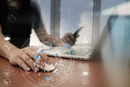 Hands of businessman using mobile phone in modern office with laptop and digital tablet computer with VR icon diagram 스톡 콘텐츠 - 92775933