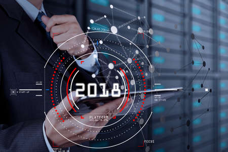 Businessman focus on year 2018. Business new year technology concept.