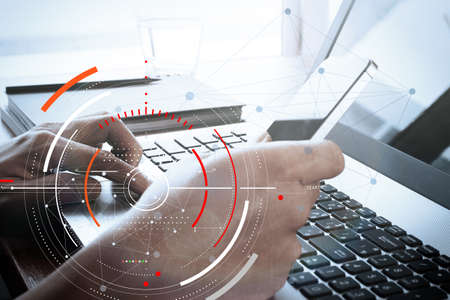 Concept of target focus digital diagram,graph interfaces,virtual UI screen,connections netwoork.Hipster finance analyst working with mobile phone and laptop at trendy office