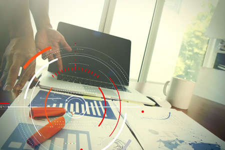 Concept of target focus digital diagram,graph interfaces,virtual UI screen,connections netwoork.Hipster finance analist working at trendy office Stok Fotoğraf