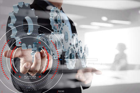 Concept of focus on target with digital diagram,graph interfaces,virtual UI screen,connections netwoork.Businessman showing gear or cog for sucess business. Banque d'images