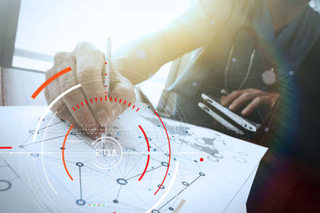 Businessman focus on year 2018 with Target lcked HUD dashboard. Business new year technology concept. Stock Photo