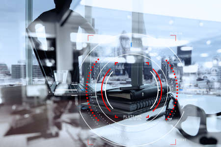 Concept of focus on target with digital diagram,graph interfaces,virtual UI screen,connections netwoork.Workspace of excusive office in modern building