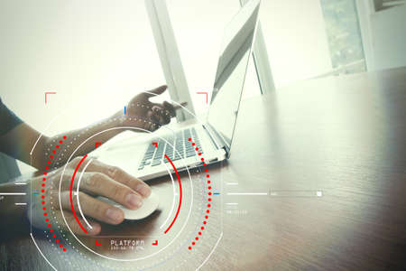 Concept of target focus digital diagram,graph interfaces,virtual UI screen,connections netwoork.Hipster finance analist working with laptop at trendy office Stockfoto
