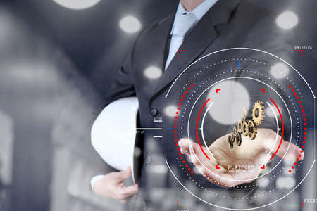 Concept of focus on target with digital diagram,graph interfaces,virtual UI screen,connections netwoork.Businessman showing gear or cog for sucess business. Standard-Bild