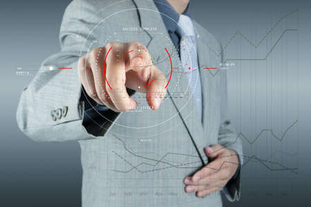 Concept of target focus digital diagram,graph interfaces,virtual UI screen,connections netwoork.Hipster finance analyst working at trendy office