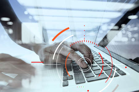 Concept of target focus digital diagram,graph interfaces,virtual UI screen,connections netwoork.Hipster finance analist working with laptop at trendy office Standard-Bild