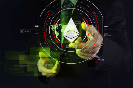 Businessman working with new modern computer and cryptocurrency virtual diagram as concept. Фото со стока