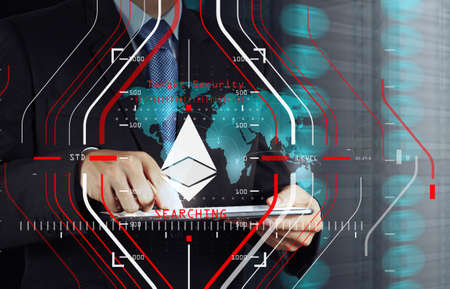 Businessman working with new modern computer and Ethereum cryptocurry virtual diagram as concept.