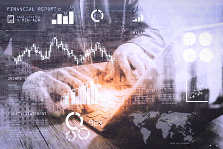 Financial report data of business operations (balance sheet and  income statement and diagram) as Fintech concept.Double exposure of success businessman using smart phone,digital tablet docking smart keyboard.