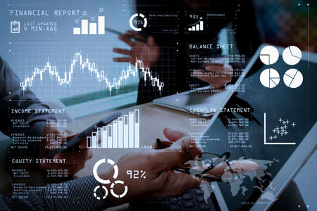 Financial report data of business operations (balance sheet and income statement and diagram) as Fintech concept.two colleague web designer discussing data and digital tablet docking keyboard and computer laptop. Stock Photo