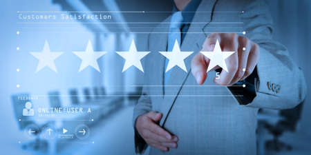 Five stars (5) rating with a businessman is touching virtual computer screen.For positive customer feedback and review with excellent performance. Archivio Fotografico - 100824576