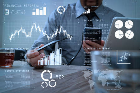 Financial report data of business operations (balance sheet and income statement and diagram) as Fintech concept.success businessman hand using eyeglass,smart phone,digital tablet docking smart keyboard. Stock Photo