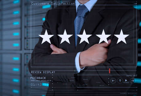 Five stars (5) rating with a businessman is touching virtual computer screen.For positive customer feedback and review with excellent performance.