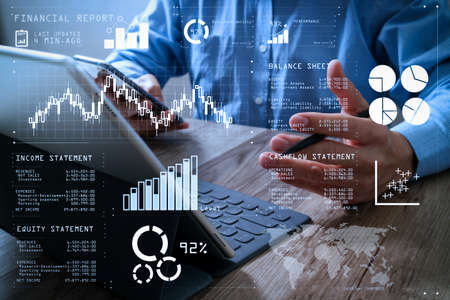 Financial report data of business operations (balance sheet and income statement and diagram) as Fintech concept.success businessman hand using stylus pen,digital tablet docking smart keyboard on wooden desk.