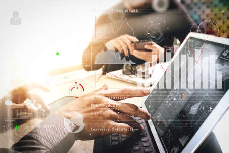 Intelligence (BI) and business analytics (BA) with key performance indicators (KPI) dashboard concept.two colleague web designer discussing data and digital tablet docking keyboard and computer laptop. Stock Photo