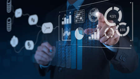 Data Management System (DMS) with Business Analytics concept. businessman working with provide information for Key Performance Indicators (KPI) and marketing analysis onn virtual computer Imagens - 101013013