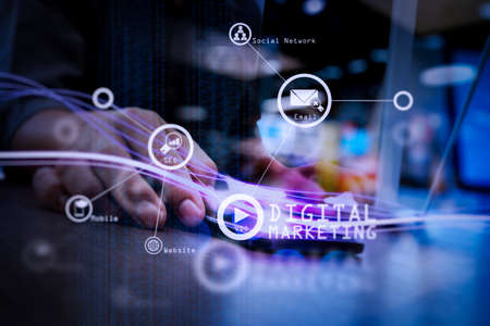 Digital marketing media (website ad, email, social network, SEO, video, mobile app) in virtual screen.Waves of blue light and businessman using on smartphone as concept.
