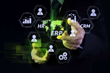 Architecture of ERP (Enterprise Resource Planning) system with connections between business intelligence (BI), production, CRM modules and HR diagram.businessman working with new modern computer. Stock Photo