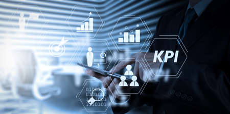 Key Performance Indicator (KPI) workinng with Business Intelligence (BI) metrics to measure achievement and planned target.businessman success working with tablet computer his board room background Stock fotó