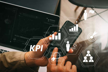 Key Performance Indicator (KPI) workinng with Business Intelligence (BI) metrics to measure achievement and planned target.hand using smart phone and digital tablet computer for online banking payment 스톡 콘텐츠