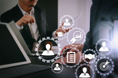 Human resources management with recruitment business working concept. HR manager is selecting candidate for hiring with virtual screen computer in meeting room.