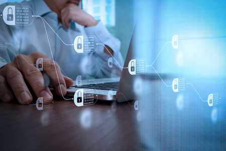 Blockchain technology concept with diagram of chain and encrypted blocks. close up of business man hand working on laptop computer with social media diagram on wooden desk