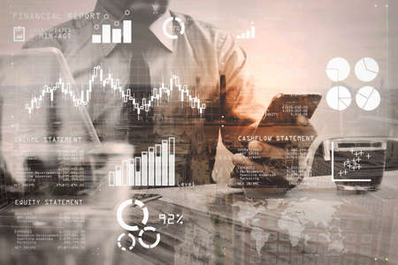 Financial report data of business operations (balance sheet and income statement and diagram) as Fintech concept.Double exposure of success businessman using smart phone,digital tablet docking smart keyboard. Stock Photo