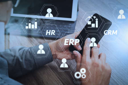 Architecture of ERP (Enterprise Resource Planning) system with connections between business intelligence (BI), production, CRM modules and HR diagram. Stock Photo