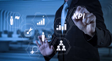 Key Performance Indicator (KPI) workinng with Business Intelligence (BI) metrics to measure achievement and planned target.businessman hand writing in the whiteboard or virtual screen Archivio Fotografico - 101656878
