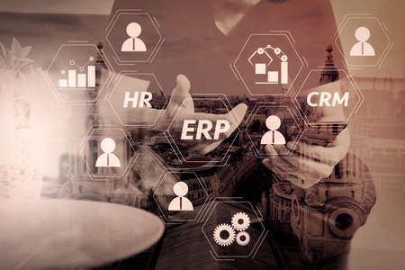 Architecture of ERP (Enterprise Resource Planning) system with connections between business intelligence (BI), production, CRM modules and HR diagram.designer man hand using smart phon for mobile payments online. 免版税图像