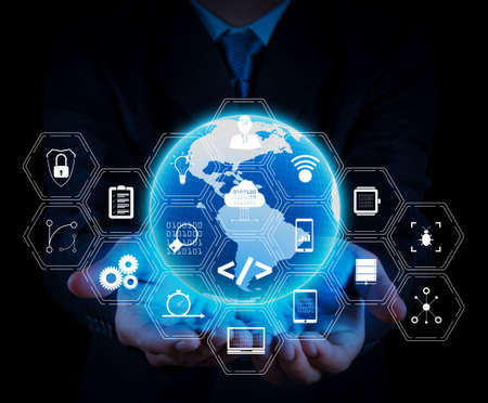 Coding software developer work with augmented reality dashboard computer icons of scrum agile development and code fork and versioning with responsive cybersecurity.businessman holding a glowing earth globe. Stock Photo