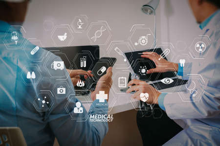 Modern VR with medical technology diagram concept.Medical doctor in white uniform gown coat consulting businessman patient having exam as Hospital professionalism concept.