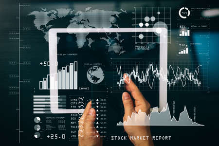 Investor analyzing stock market report and financial dashboard with business intelligence (BI), with key performance indicators (KPI).cyber security internet and networking concept.Businessman hand working with VR. Banque d'images