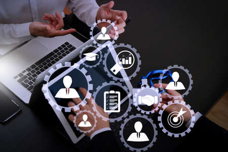 Human resources management with recruitment business working concept. HR manager is selecting candidate for hiring with virtual screen computer.