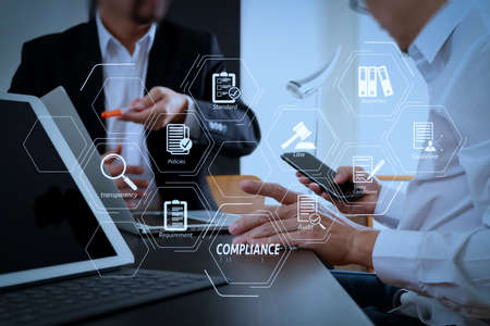 Compliance Virtual Diagram for regulations, law, standards, requirements and audit.co working team meeting concept,businessman using smart phone and digital tablet and laptop computer in modern office