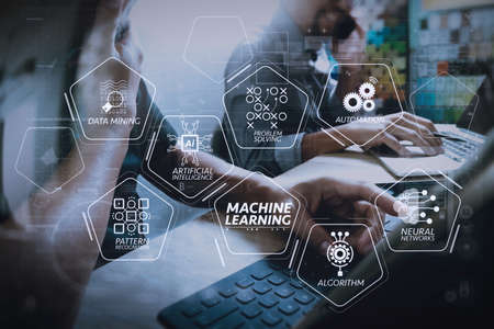 Machine learning technology diagram with artificial intelligence (AI),neural network,automation,data mining in VR screen.Coworking process, entrepreneur team working in creative office space. using digital tablet. Stock Photo