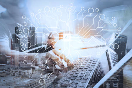 Artificial Intelligence (AI),machine learning with data mining technology on virtual dachboard.Double Exposure,Outsource Developer working on marble Desk Working Laptop Computer Mobile Application Software. Stock Photo