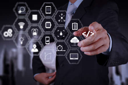 Coding software developer work with augmented reality dashboard computer icons of scrum agile development and code fork and versioning with responsive cybersecurity.smart engineer working on new technology. Stock Photo
