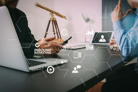 Inbound marketing business with virtual diagram dashboard and Online or permission market concept.co working team meeting concept,businessman using smart phone and digital tablet and laptop computer in modern office.                                Stock Photo
