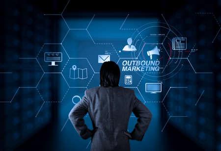 Outbound marketing business virtual dashboard with Offline or interruption marketing.businessman working with new computer. Foto de archivo