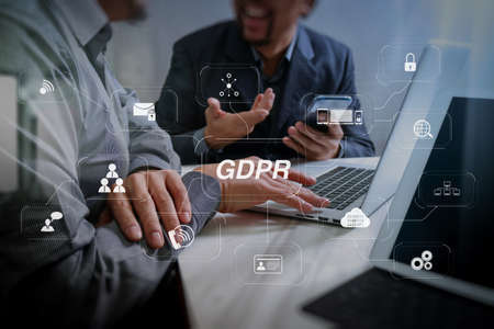 GDPR. Data Protection Regulation with Cyber security and privacy virtual diagram.Business team meeting. Photo professional investor working new start up project. Finance task.Digital tablet docking keyboard laptop computer.